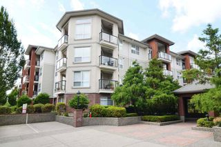 "Photo 1: 406 20239 MICHAUD Crescent in Langley: Langley City Condo for sale in ""City Grande"" : MLS®# R2062935"