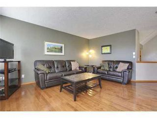 Photo 4: 290 COUGARSTONE Circle SW in Calgary: 2 Storey for sale : MLS®# C3586992