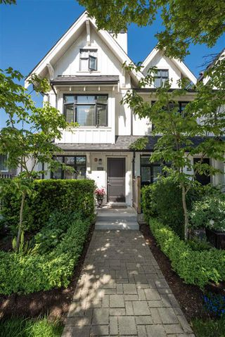 "Photo 1: 5757 ST. GEORGE Street in Vancouver: Fraser VE Townhouse for sale in ""ST. GEORGE"" (Vancouver East)  : MLS®# R2172060"