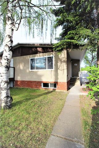 Photo 2: 3318A 38 Street SW in Calgary: Glenbrook House for sale : MLS®# C4120224