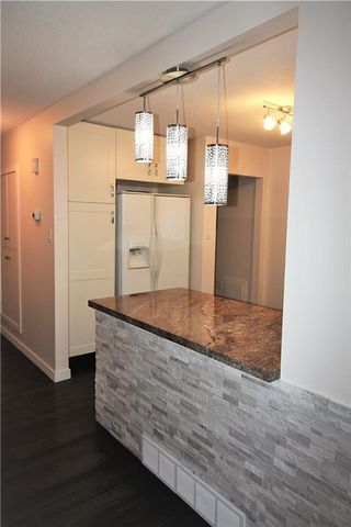 Photo 5: 3318A 38 Street SW in Calgary: Glenbrook House for sale : MLS®# C4120224
