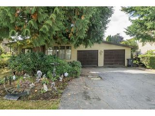 Photo 1: 13874 FALKIRK Drive in Surrey: Bear Creek Green Timbers House for sale : MLS®# R2307470