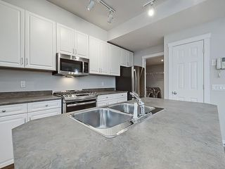 Photo 8: 302 Garrison Square SW in Calgary: Garrison Woods Row/Townhouse for sale : MLS®# C4225939