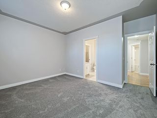 Photo 21: 302 Garrison Square SW in Calgary: Garrison Woods Row/Townhouse for sale : MLS®# C4225939
