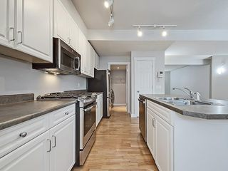 Photo 9: 302 Garrison Square SW in Calgary: Garrison Woods Row/Townhouse for sale : MLS®# C4225939