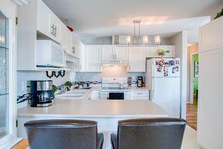 "Photo 6: 309 20245 53 Avenue in Langley: Langley City Condo for sale in ""METRO 1"" : MLS®# R2371361"