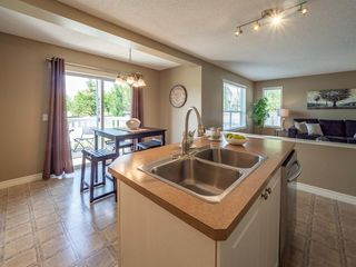 Photo 13: 15 CRYSTAL SHORES Court: Okotoks Detached for sale : MLS®# A1019457