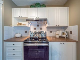 Photo 10: 15 CRYSTAL SHORES Court: Okotoks Detached for sale : MLS®# A1019457