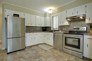 Photo 12: 11844 ELBOW Drive SW in Calgary: Canyon Meadows Detached for sale : MLS®# A1036334