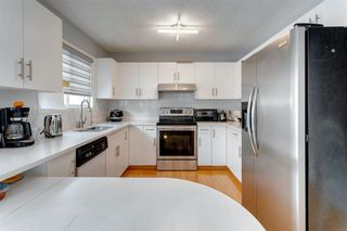Photo 13: 89 SIDON Crescent SW in Calgary: Signal Hill Detached for sale : MLS®# A1050273