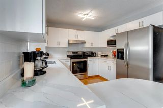 Photo 14: 89 SIDON Crescent SW in Calgary: Signal Hill Detached for sale : MLS®# A1050273