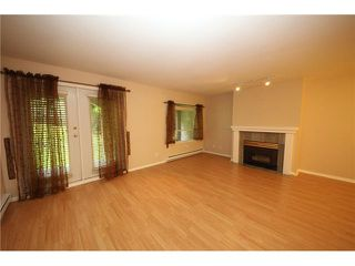 "Photo 3: 105 515 WHITING Way in Coquitlam: Coquitlam West Condo for sale in ""Brookside Manor"" : MLS®# V903579"