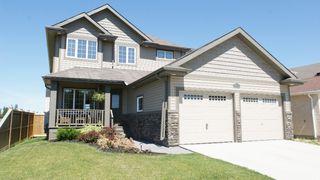 Photo 1: 248 Reg Wyatt Way in Winnipeg: North Kildonan Residential for sale (North East Winnipeg)  : MLS®# 1215336