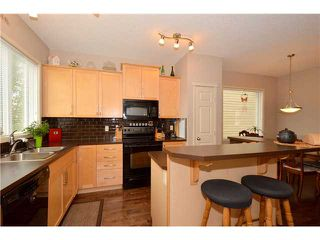 Photo 7: 84 SUNSET Heights: Cochrane Residential Detached Single Family for sale : MLS®# C3620062