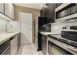 "Photo 7: 203 555 W 14TH Avenue in Vancouver: Fairview VW Condo for sale in ""CAMBRIDGE PLACE"" (Vancouver West)  : MLS®# V1117679"