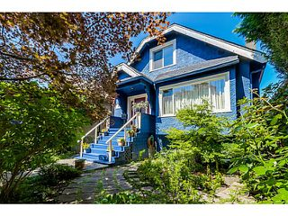 Photo 1: 2157 E 1ST Avenue in Vancouver: Grandview VE House for sale (Vancouver East)  : MLS®# V1137465