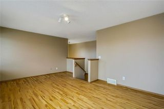 Photo 24: 38 SOMERSIDE Crescent SW in Calgary: Somerset House for sale : MLS®# C4142576