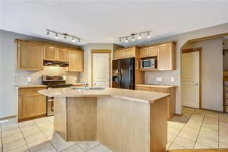 Photo 9: 38 SOMERSIDE Crescent SW in Calgary: Somerset House for sale : MLS®# C4142576