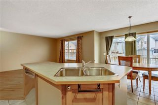Photo 15: 38 SOMERSIDE Crescent SW in Calgary: Somerset House for sale : MLS®# C4142576