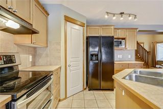 Photo 12: 38 SOMERSIDE Crescent SW in Calgary: Somerset House for sale : MLS®# C4142576