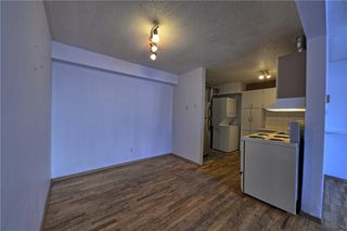 Photo 3: 102 3809 45 Street SW in Calgary: Glenbrook House for sale : MLS®# C4165453