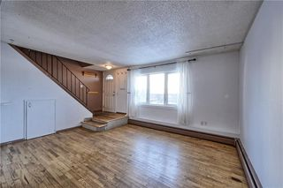 Photo 5: 102 3809 45 Street SW in Calgary: Glenbrook House for sale : MLS®# C4165453
