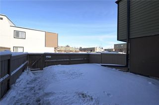 Photo 9: 102 3809 45 Street SW in Calgary: Glenbrook House for sale : MLS®# C4165453