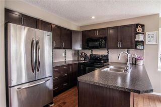 Photo 6: 49 105 DRAKE LANDING Common: Okotoks Row/Townhouse for sale : MLS®# C4201699