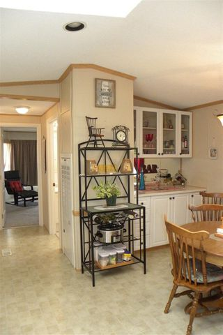 "Photo 12: 12 7610 EVANS Road in Chilliwack: Sardis West Vedder Rd Manufactured Home for sale in ""Cottonwood Village- Gate 4"" (Sardis)  : MLS®# R2299969"