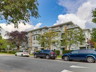 "Main Photo: 301 6198 ASH Street in Vancouver: Oakridge VW Condo for sale in ""THE GROVE"" (Vancouver West)  : MLS®# R2332430"