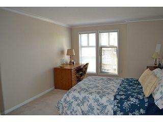 "Photo 11: 310 15350 19A Avenue in Surrey: King George Corridor Condo for sale in ""Stratford Gardens"" (South Surrey White Rock)  : MLS®# F1409599"