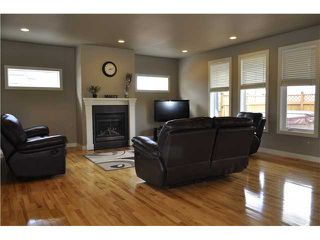Photo 2: 242 CANOE Square SW: Airdrie Residential Detached Single Family for sale : MLS®# C3618533
