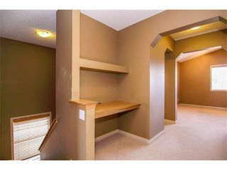 Photo 10: 136 COUGAR RIDGE Circle SW in Calgary: Cougar Ridge House for sale : MLS®# C4005616