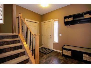 Photo 2: 136 COUGAR RIDGE Circle SW in Calgary: Cougar Ridge House for sale : MLS®# C4005616