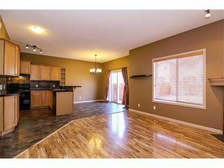 Photo 5: 136 COUGAR RIDGE Circle SW in Calgary: Cougar Ridge House for sale : MLS®# C4005616