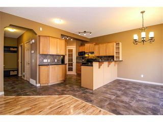 Photo 7: 136 COUGAR RIDGE Circle SW in Calgary: Cougar Ridge House for sale : MLS®# C4005616