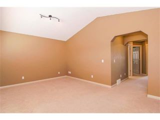 Photo 12: 136 COUGAR RIDGE Circle SW in Calgary: Cougar Ridge House for sale : MLS®# C4005616