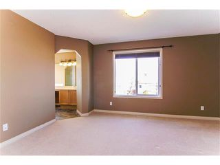 Photo 15: 136 COUGAR RIDGE Circle SW in Calgary: Cougar Ridge House for sale : MLS®# C4005616