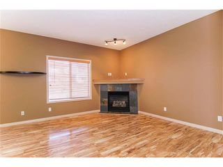 Photo 4: 136 COUGAR RIDGE Circle SW in Calgary: Cougar Ridge House for sale : MLS®# C4005616