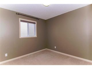 Photo 18: 136 COUGAR RIDGE Circle SW in Calgary: Cougar Ridge House for sale : MLS®# C4005616