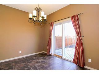 Photo 6: 136 COUGAR RIDGE Circle SW in Calgary: Cougar Ridge House for sale : MLS®# C4005616