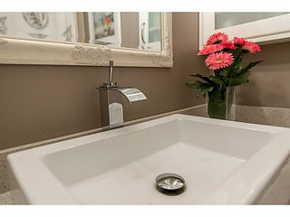 """Photo 13: 214 1345 W 15TH Avenue in Vancouver: Fairview VW Condo for sale in """"SUNRISE WEST"""" (Vancouver West)  : MLS®# V1118182"""