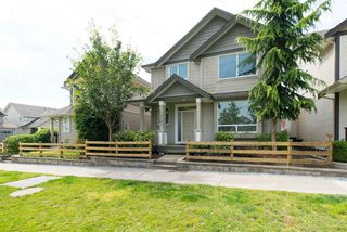"""Photo 2: 19495 70A Avenue in Surrey: Clayton House for sale in """"CLOVERDALE"""" (Cloverdale)  : MLS®# R2089947"""