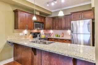 """Photo 8: 306 20286 53A Avenue in Langley: Langley City Condo for sale in """"Casa Verona"""" : MLS®# R2266915"""