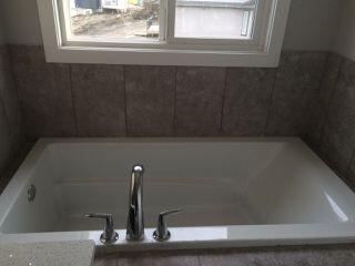 Photo 13: 2131 26 Street in Edmonton: Zone 30 House for sale : MLS®# E4151952