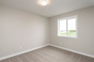 Photo 25: 563 Ebbers Way NW in Edmonton: Zone 02 Attached Home for sale : MLS®# E4173724