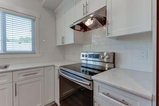 Photo 18: 12236 89 Street in Edmonton: Zone 05 House Half Duplex for sale : MLS®# E4200491