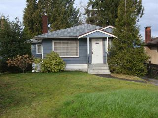 Photo 1: 7773 ROSEWOOD Street in Burnaby: Burnaby Lake House for sale (Burnaby South)  : MLS®# R2026201