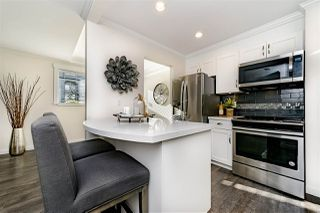 "Photo 1: 104 2915 GLEN Drive in Coquitlam: North Coquitlam Condo for sale in ""GLENBOROUGH"" : MLS®# R2332983"