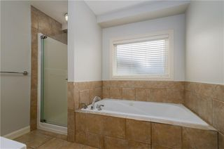 Photo 20: 242 STRATHRIDGE Place SW in Calgary: Strathcona Park Detached for sale : MLS®# C4246259